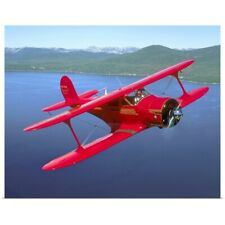 Poster Print Wall Art entitled Beechcraft Model 17 Staggerwing flying over Lake