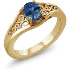 0.95 Ct Oval Royal Blue Mystic Topaz 14K Yellow Gold Ring