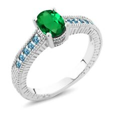 1.10 Ct Oval Simulated Emerald and Blue Simulated Topaz 925 Sterling Silver Ring