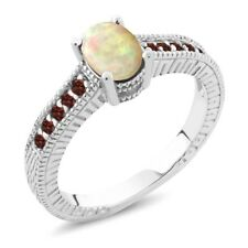 0.71 Ct Oval Cabochon White Ethiopian Opal Red Garnet 925 Sterling Silver Ring
