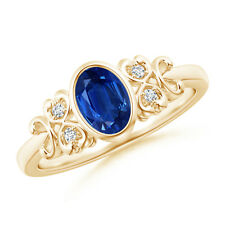 Vintage-Style Oval Sapphire Bezel Ring with Diamond Accents in 14K Yellow Gold