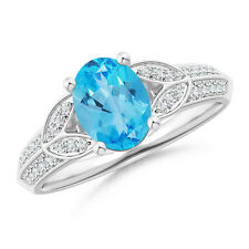 Natural Oval Blue Topaz Solitaire Ring with Diamonds in 14k Gold / Platinum
