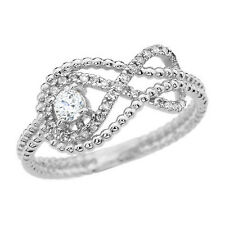 14k White Gold Infinity Beaded Ring with a 0.10 ct Diamond & 32 Small Diamonds