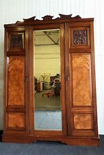 Antique Victorian carved mahogany and walnut triple door wardrobe