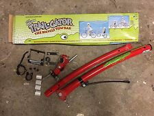 Trail-Gator tag-along / tow-bar for towing child's bike bicycle