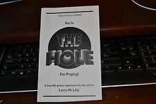 Put in the Hole for Praying; Larry Lilly