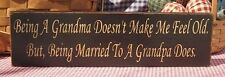 Being A Grandma Doesn't Make Me Feel Old Being Married To A Grandpa Does. sign