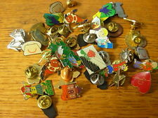 Assorted charity and novelty pin badges. 99p each. Good selection