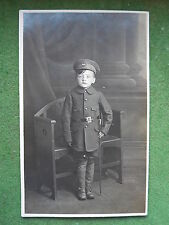 WW1 Young Boy in Patriotic Military Uniform & Swagger Stick Real Photo Postcard.