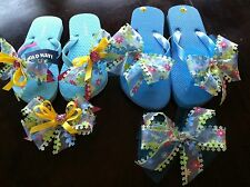 Girl's Beauty in Blue Flip Flops With Matching Hair Bow