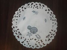 "7"" Round Doily with Blue Seashells on Bleached White Material"