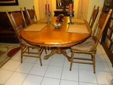 Nostalgia Oval Sunburst Pedestal Table 5 Piece Dining Set in Medium Oak Finish