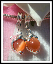 EUROPEAN OR LOBSTER CLASP CLIP ON STYLE ORANGE CAT'S EYE BEAD + DOLPHIN CHARMS