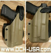 Custom Kydex Holster for Glock with light, Level 2 Safety with Blackhawk Paddle