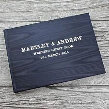 Handmade personalised wedding guest book in navy watermarked satin A5 landscape