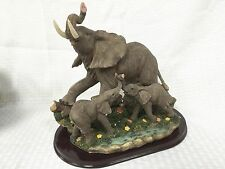 """10""""L Hand Carved Poly Resin Mom & Babies Elephant with Wood Base"""