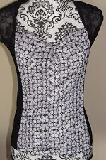 BEBE black & white floral print fitted nylon top w/ sheer sides & sleeve, Size M