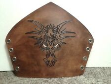 Hand-made carved leather bracers with dragon face carving,  antique brown finish