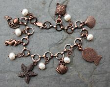 Ocean Bounty Charm Bracelet- copper, pearl, fish, shell