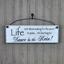 LIFE ISN'T ABOUT WAITING FOR THE STORM TO PASS LEARNING TO DANCE IN THE RAIN