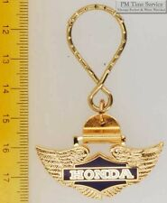 Sturdy key chain with a fancy gold-toned Honda wings shield