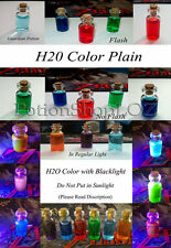 The Legend of Zelda potions in a bottle, H2O blacklight key chain and phone plug
