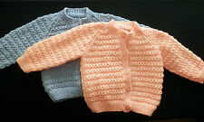 Hand knitted baby cardigan. 9-12 months. Available in Peach or Lilac.