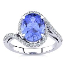 14K WHITE GOLD 2 3/4 CARAT OVAL SHAPE GENUINE TANZANITE AND HALO DIAMOND RING