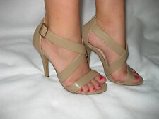 "New Taupe (Light Brown) with 4.25"" High Heel. Strap Crosses in Front of Ankle."