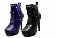Ladies patent high heel ankle boots with elastic sides and studs