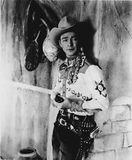 Roy Rogers Leaning on Wall in Cowboy Outfit High Quality Photo
