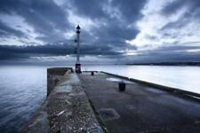Sea Wall and Harbour Light at Bridlington, East Riding of Yorkshire, England,