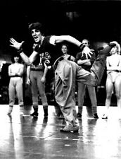 Chorus Line with A Man Dancing in Tank top High Quality Photo