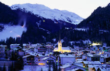 Overhead of snow-covered town and mountains, early morning. Photos by Getty