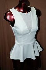 BEBE Ivory White Peplum Top Super Cute and Sexy Sleeveless Career Top Size XS-XL