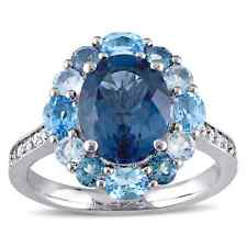 Miadora Sterling Silver Oval-cut Blue and White Topaz Halo Cocktail Ring