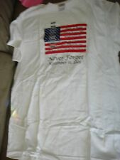 WHITE TEE SHIRT WITH FLAG NEVER FORGET SEPTEMBER 11, 2001