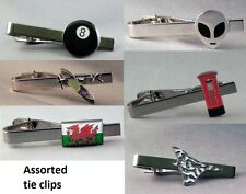 Assorted selection of Tie clips. Spitfire. Roundel. St Christopher. Alien. Taxi
