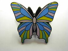 Butterfly pin badge. Brightly coloured butterfly.