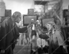 Mary Pickford and cast member enjoy ice cream cone film Sparrows 8b4-869