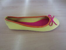 Ladies spot on dolly shoes,textile with a patent orange trim and pink bow