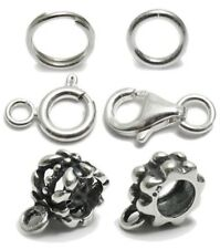 Charm bail replacement rings, locks and converter beads