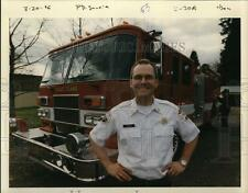 1996 Press Photo Ron Murray with a fire truck behind him  - ora60880
