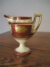 ANTIQUE FOOTED CREAMER OR PITCHER WITH HAND PAINTED ROSES AND MUCH GOLD TRIM -