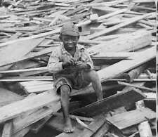 Galveston Hurricane of 1900 African American child on destroyed home reprint