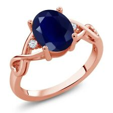 2.55 Ct Oval Blue Sapphire White Topaz 18K Rose Gold Plated Silver Ring