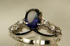 SAPPHIRE 1.5 CZ WITH CLEAR CZ ACCENTS 18K WHITE GOLD (GP) RING RHODIUM FINISHED