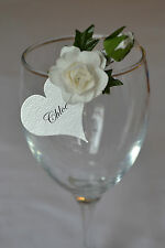 Pretty vintage style roses flowers on pegs wedding table decoration place cards