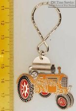 Sturdy key chain with a fancy silver-toned Minneapolis Moline tractor shield