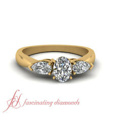 .85 Ct Oval & Pear Shaped Diamond Trio Stone Engagement Rings In 18K Yellow Gold
